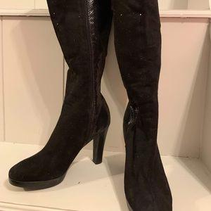 Knee high snakeskin heeled boots